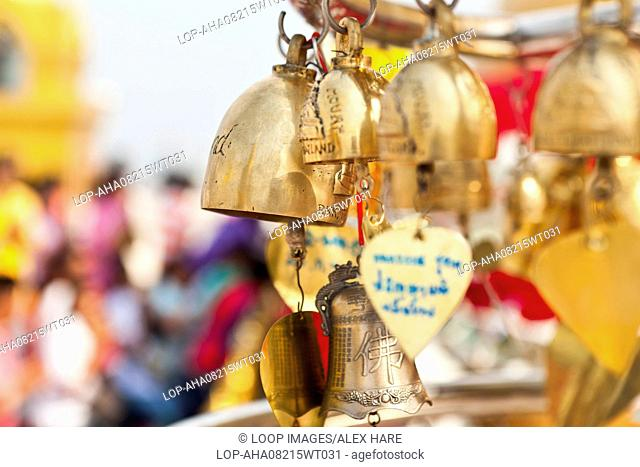 Wishing bells and the golden temple at the summit of Golden Mount in Bangkok