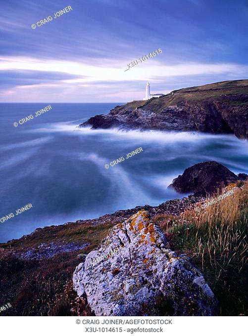 Stinking Cove and the lighthouse at Trevose Head at dusk viewed from Dinas Head on the North Cornwall coast near Padstow, Cornwall, England, United Kingdom