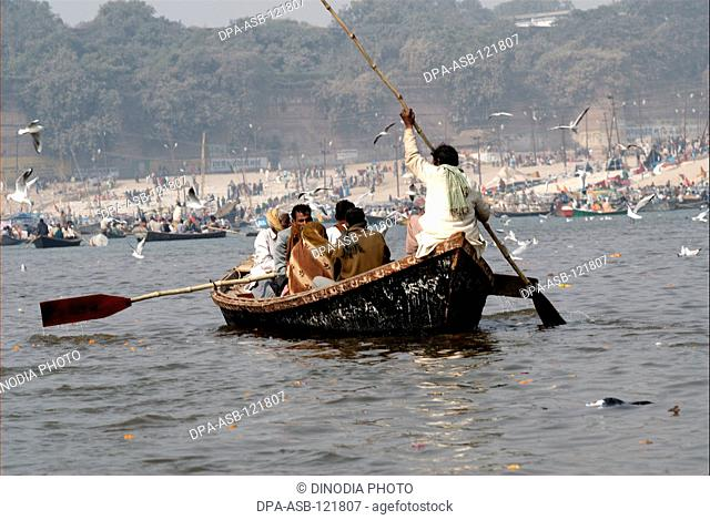Boats or ferries on the banks of Ganges during the Ardh Kumbh Mela ; one of the world's largest religious festivals at Allahabad ; Uttar Pradesh ; India