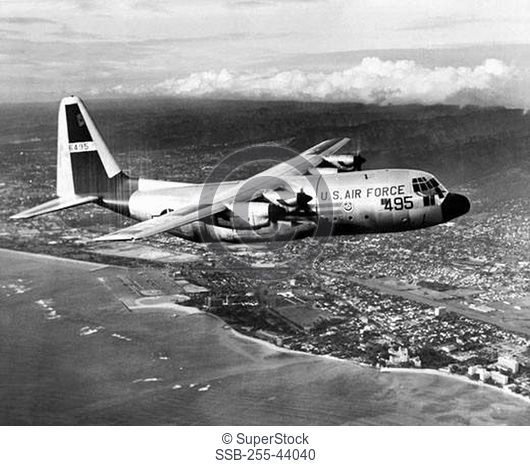 Military airplane in flight, Waikiki, Oahu, Hawaii, USA