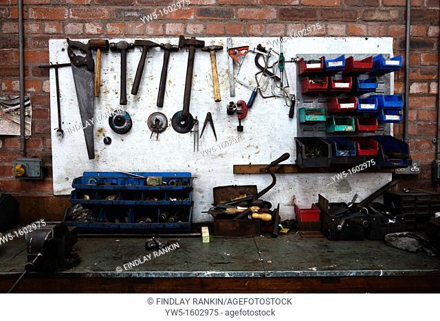 Engineer's workbench with assorted tools lying about