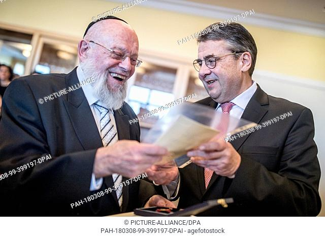 08 March 2018, Germany, Berlin: German Foreign Minister Sigmar Gabriel (R) of the Social Democratic Party (SPD) awarding the Order of Merit of the Federal...