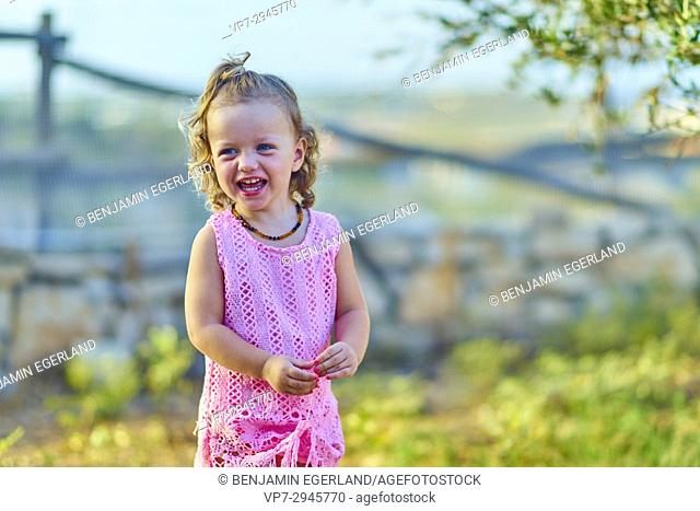 young vibrant female toddler outside in nature. Australian ethnicity. During holiday stay in Hersonissos, Crete, Greece