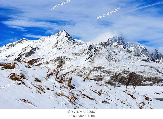 Rugged snow covered mountains, viewed from Little St Bernard Pass; Italy
