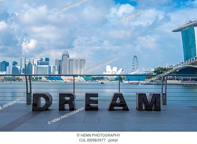 Dream, sculpture, with skyline of Singapore in background