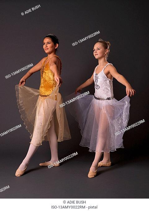 Two ballerinas facing camera left