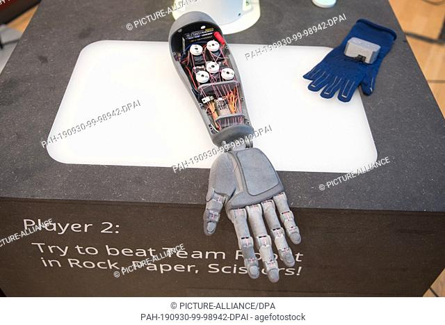 30 September 2019, Saxony, Dresden: The arm of a robot lies on a box at the IEEE 4th 5G Summit Dresden. From 30 September to 2 October 2019