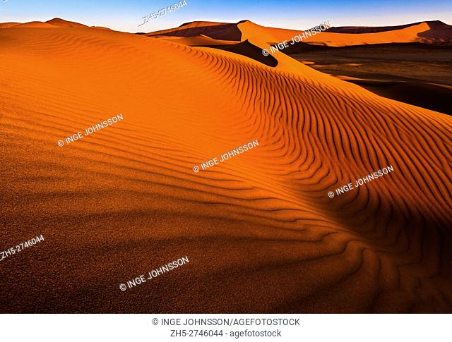 Sossusvlei is a salt and clay pan surrounded by high red dunes, located in the southern part of the Namib Desert, in the Namib-Naukluft National Park of Namibia