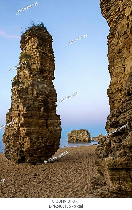 Rock columns at the water's edge along the coast; South Shields, Tyne and Wear, England