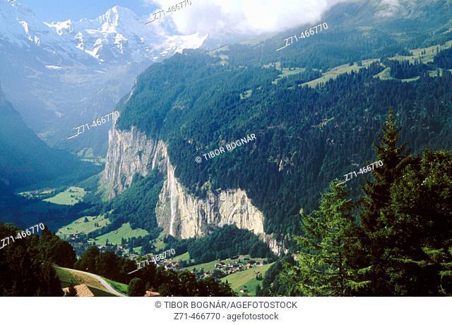 Lauterbrunnen, Staubbach Falls and Breithorn peak. Bernese Oberland. Switzerland