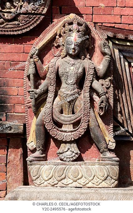 Nepal, Changu Narayan. Hindu Stone Sculpture (probably Vishnu) Flanking Entrance to Temple