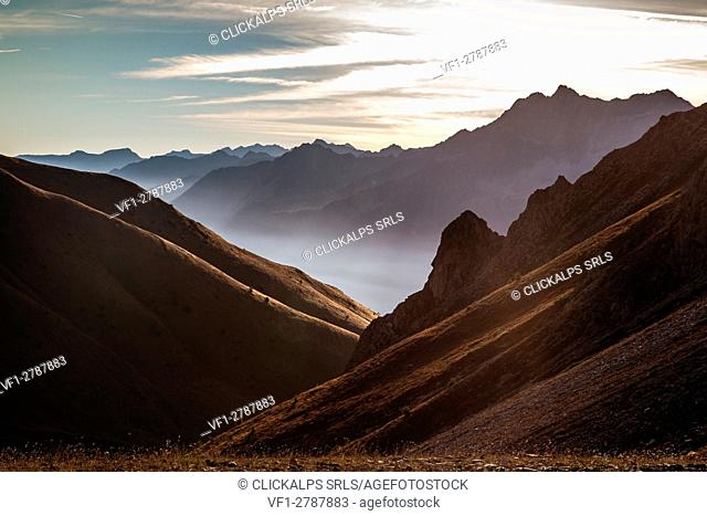 A suggestive shot of the profiles of the Val di Sole in the early morning lights - Val di Sole, Camonica valley Lombardy, Italy. Europe
