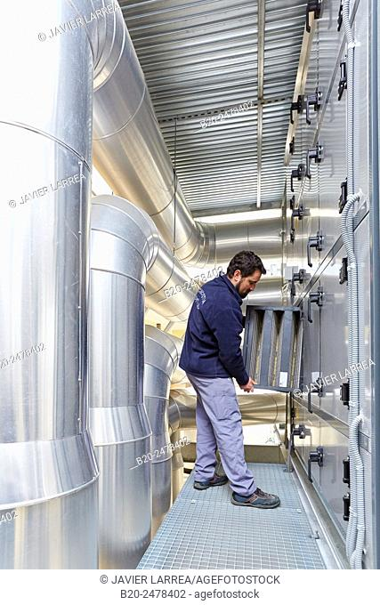 Maintenance worker, Installation of air conditioning, Ventilation air filters of the operating rooms, Hospital Donostia, San Sebastian, Gipuzkoa, Basque Country