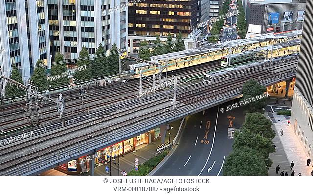 Japan-Tokyo City-Ginza District-The Bullet train and trains through Yurakucho Station and Marunouchi Skyline