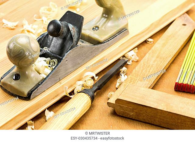 Set of carpenters working tools: plane, chisel, square, folding rule