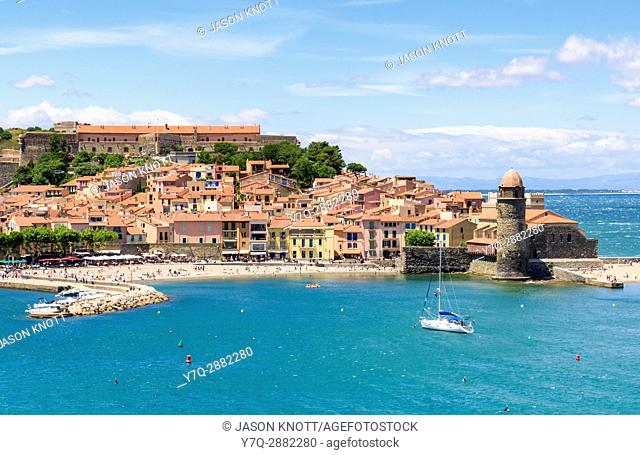 The old town and landmark bell tower of Notre Dame des Anges next to St. Vincent Beach, Collioure, Côte Vermeille, Céret, Pyrénées-Orientales, Occitanie, France