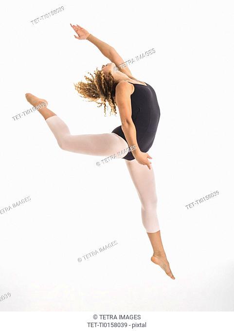 Female ballet dancer during practicing, studio shot