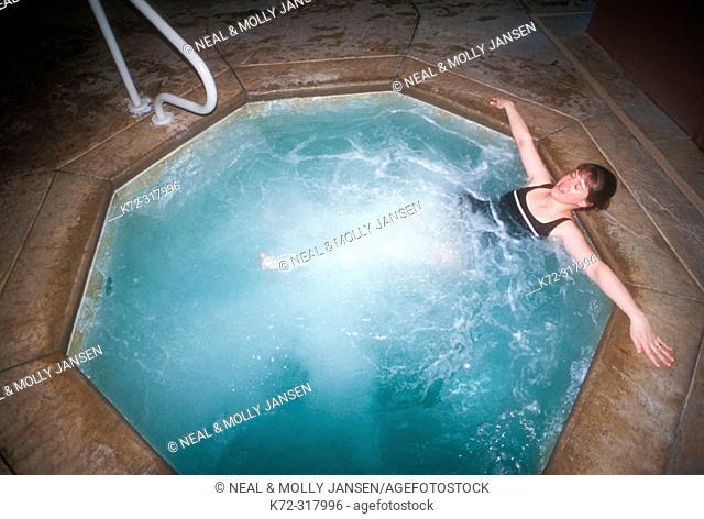 Tourist in hotel hot tub. Missouri, USA