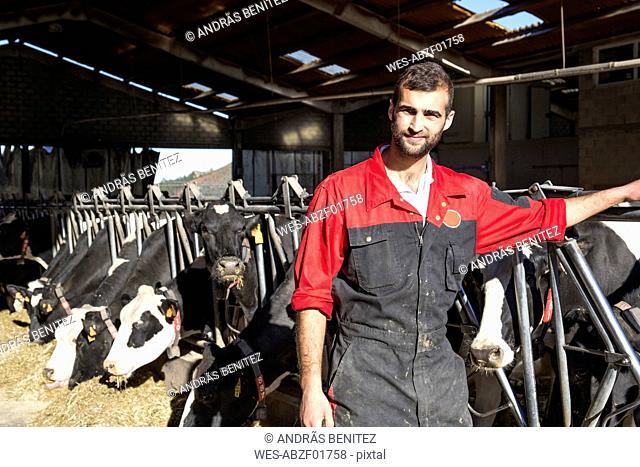 Portrait of farmer on a cow farm