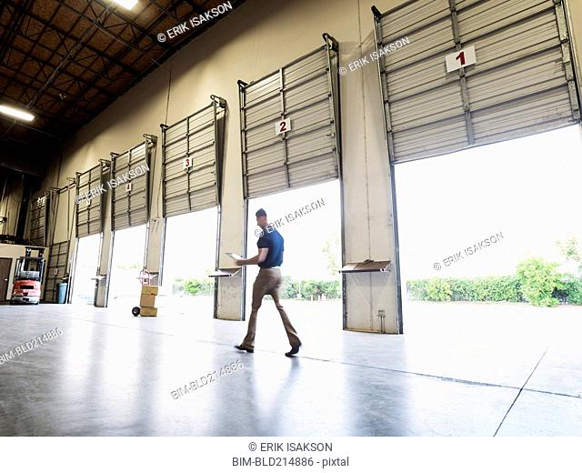 Blurred view of Caucasian worker walking in warehouse