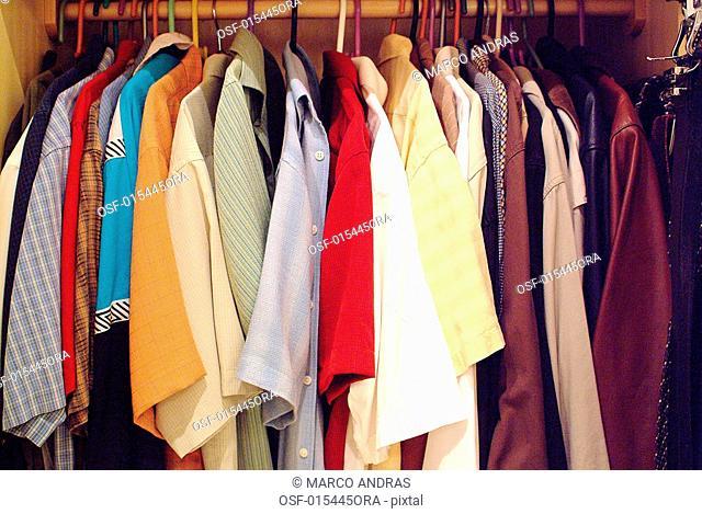 a man closet part with shirts