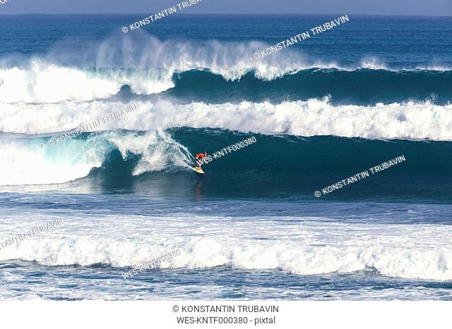 Indonesia, Bali, Surfer on a wave