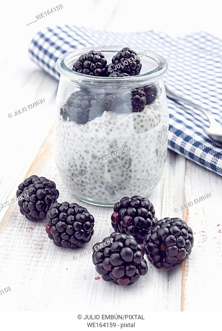 chia smoothie with berries on white wooden board