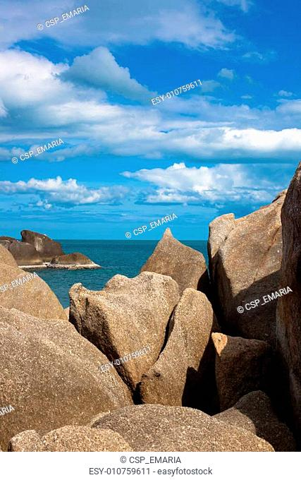 sea on tropical island with stones