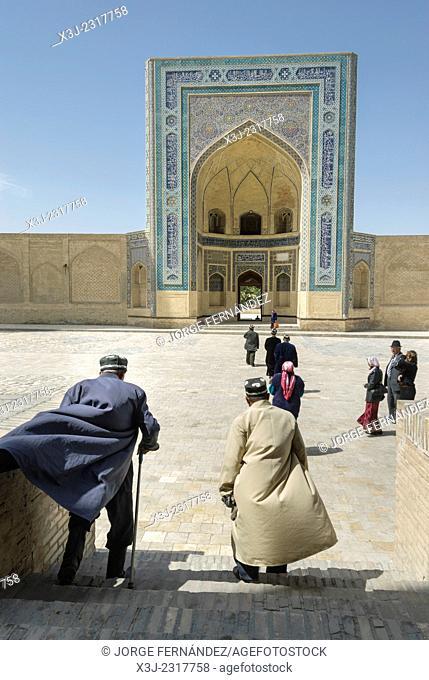 People at Mir-i-Arab madrassa, Bukhara, Uzbekistan, Asia