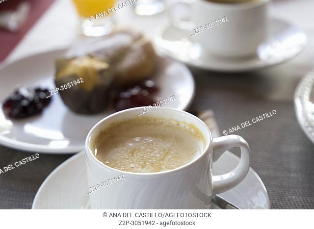 Coffee cup on breakfast table