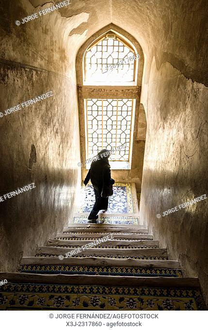 Iranian woman walking down the stairs, Isfahan, Iran