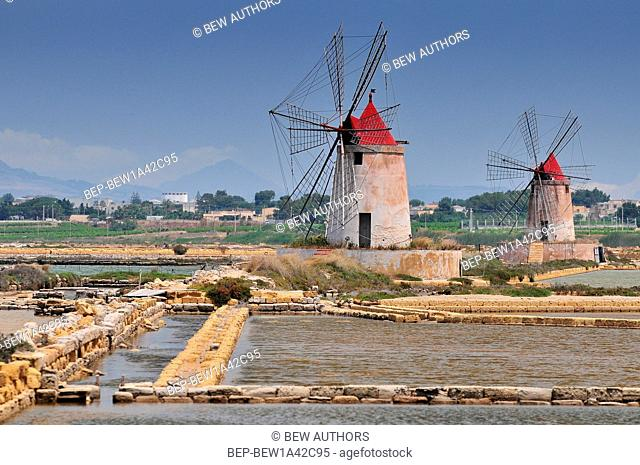 Windmills and the oldest Europe's salt ponds in Sicily Italy between Marsala and Trapani
