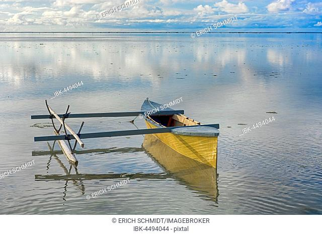 Outrigger boat in Aitutaki atoll, Cook Islands