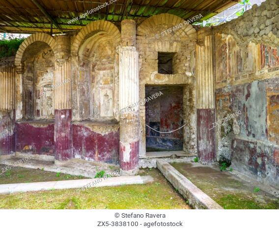 Nymphaeum (grotto with a natural water supply dedicated to the nymphs) with a painted facade and central fountain and embellished with niches decorated with...