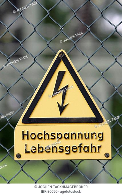 DEU, Germany: High voltage, keep off. Warning sign at an electrical power station