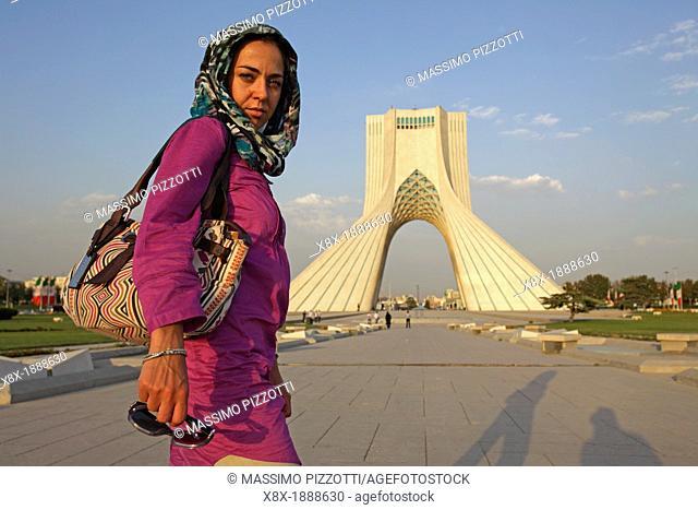 Caucasian woman at Azadi Tower, or King Memorial Tower, Teheran, Iran