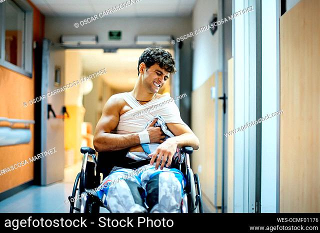 Young man sitting in wheel chair in hospital