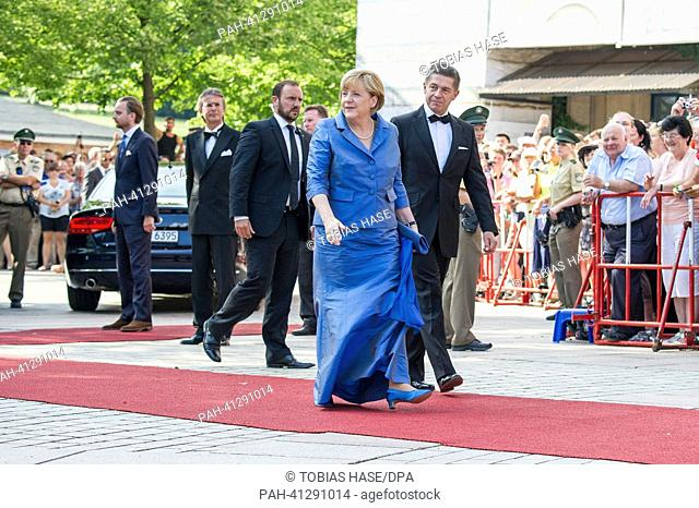 German Chancellor Angela Merkel (CDU) and her husband Joachim Sauer arrive at the opening of the Bayreuth Festival 2013 in Bayreuth, Germany, 25 July 2013