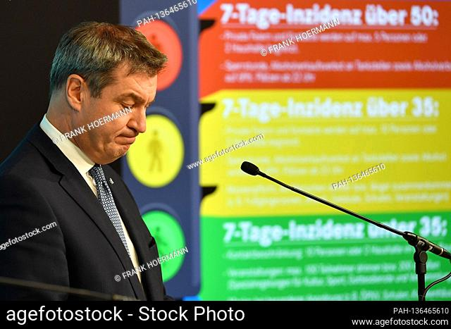 Markus SOEDER (Prime Minister of Bavaria and CSU Chairman) speaks in front of the projection of the corona traffic light for Bavaria with the various incidence...