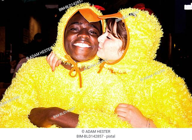 Couple kissing in chicken costumes