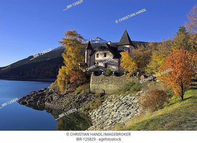 A villa built like a castle at the Reschen lake, Reschen pass, South Tyrol, Italy
