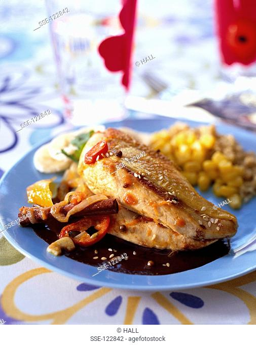 Chicken with spices and cocoa