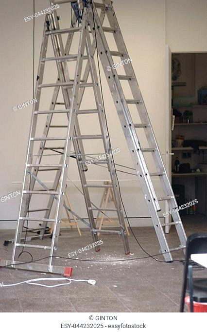 Fold-up ladders in a newly renovated interior of a shop or office space