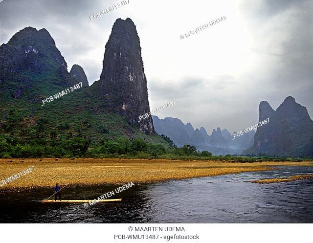 Woman on raft on the Li River