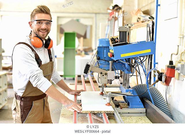 Portrait of confident carpenter in his workshop