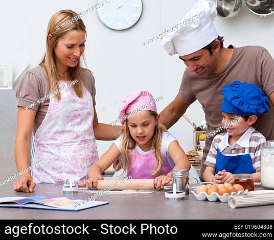 Parents helping children baking in the kitchen
