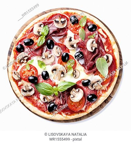 Italian pizza with salami, mushrooms, olives and basil leaves on white background