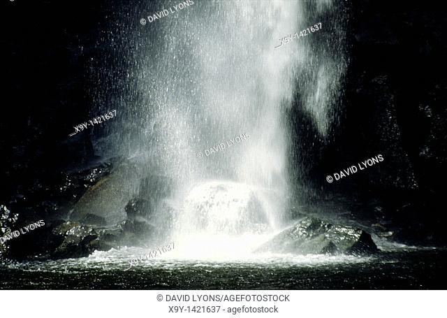 waterfall cascade on black rocks