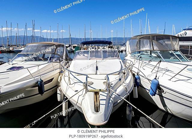 Motorboats, sailing boats and yachts moored in the marina at Yvoire along Lake Geneva / lac Léman, Haute-Savoie, France