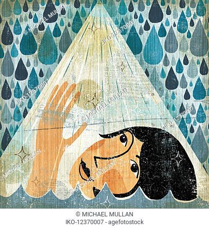 Woman drowning reaching towards beam of light in rain